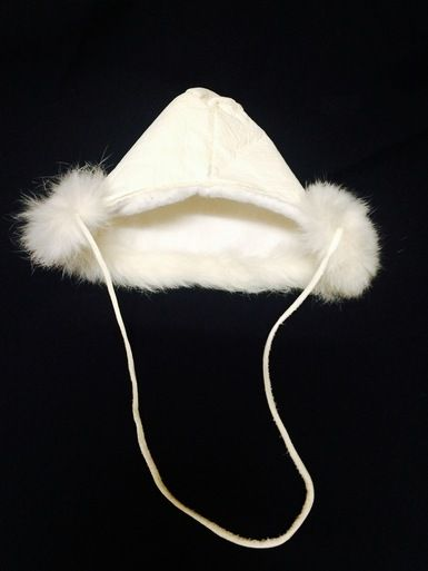 Osawamick's Wingush Crafts White baby hat made out of moose hide and rabbit fur .  0 - 6 months