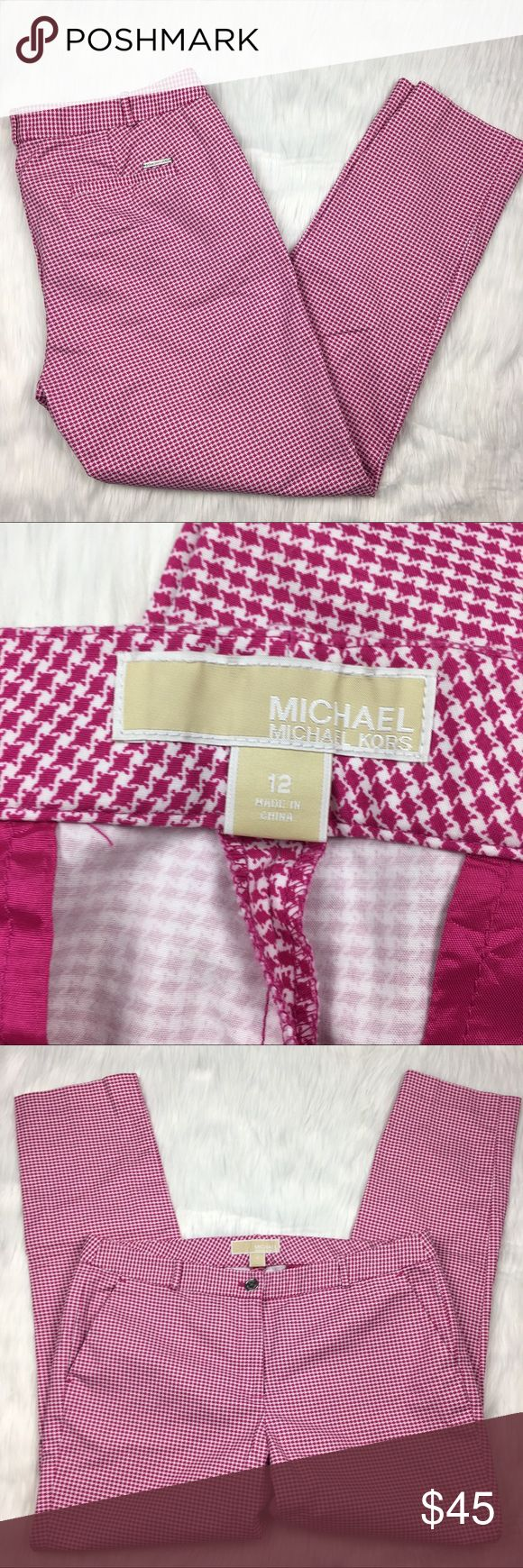 """Michael Kors Houndstooth Pink Ankle Pants michael by michael kors pink and white houndstooth trousers. skinny ankle length pants. flat waistband and pockets. a fun twist on a classic style. flattering and beautiful!  size: 12 measurements: waist 17.5"""" across / inseam 28"""" hips 20"""" across / rise 9""""  fabric content: cotton spandex blend washing instructions: machine wash flaws: none discounts: 10% off bundles of 2 items and 15% off bundles of 3+ items MICHAEL Michael Kors Pants Ankle & Cropped"""