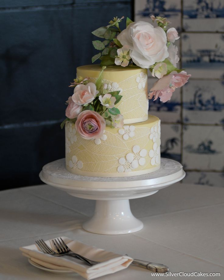 white chocolate ganache and sugar lace cover this wedding cake with handcrafted edible flowers. Black Bedroom Furniture Sets. Home Design Ideas