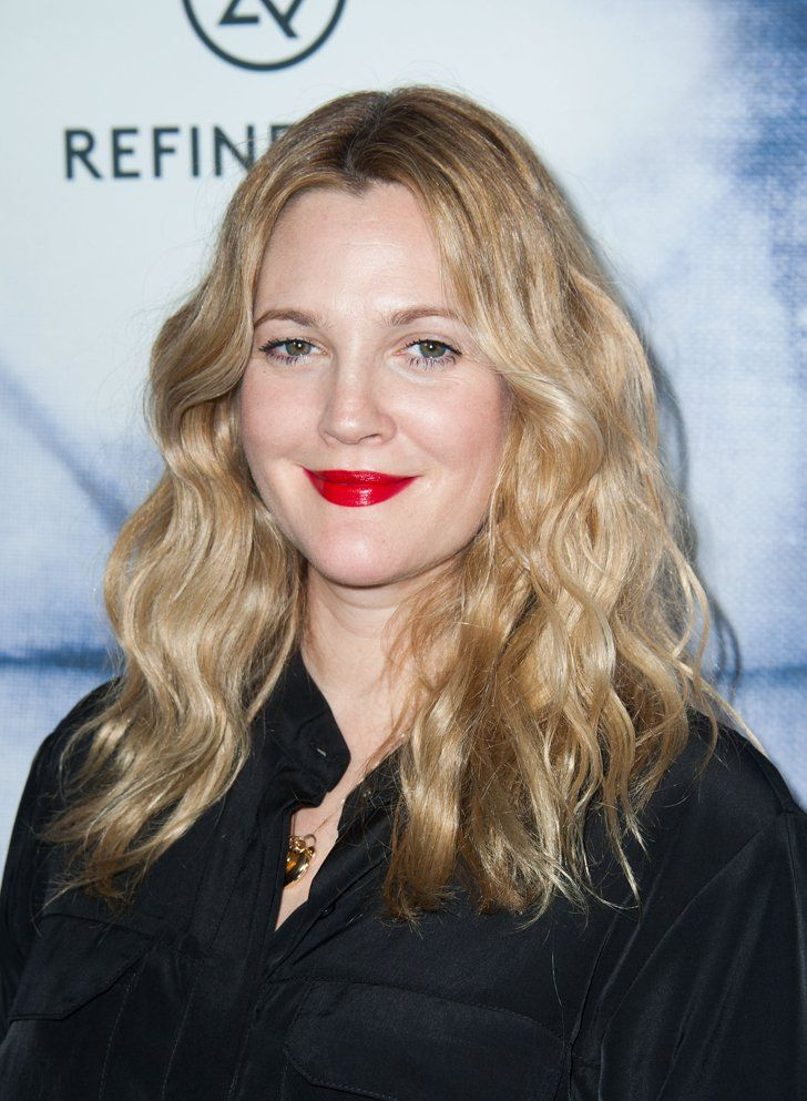 Pin for Later: Can't-Miss Celebrity Pics!  Drew Barrymore rocked a glamorous red lip for the Refinery29 Holiday Party in LA on Wednesday.
