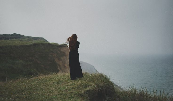 She watched the waves as someone watches a loved one. With complete mystery and complete understanding.