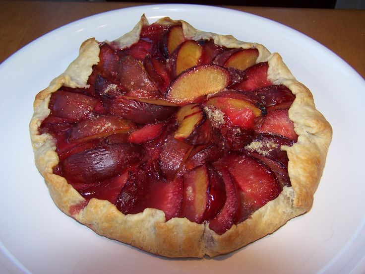 Rustic Pluot Tart refrigerate pastry, roll 18 inch circle     375 degrees.  filling:  Combine ½ cup sugar ¼ cup flour ¼ cup of toasted chopped walnuts 3 TBSP oat bran   Leaving a 2 inch border, spread over rolled out dough.  Pit, slice, arrange 1½ pounds of pluots. ½ pound of plums   Sprinkle with ¼ cup raw sugar   Fold edges of the pastry Brush with milk. Transfer to a baking sheet with parchment Bake  45 minutes  Cool on a rack   www.roundthetable.net