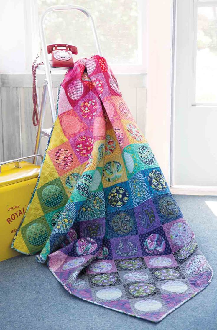 Create visual appeal with unique and enticing color arrangements in rainbow quilts! Purple quilts are lovely, but rainbow quilts are a…