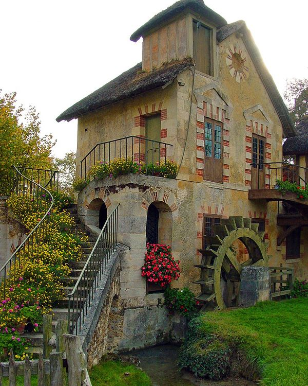 The World's 15 Storybook Cottage Homes A cottage in the Hamlet of Marie Antoinette, Versailles, France
