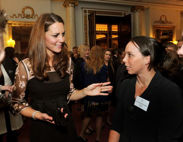 Catherine, Duchess of Cambridge talks to Gymnast Beth Tweddle during a reception held for Team GB Olympic and Paralympic London 2012 medalists at Buckingham Palace on October 23, 2012 in London, England.