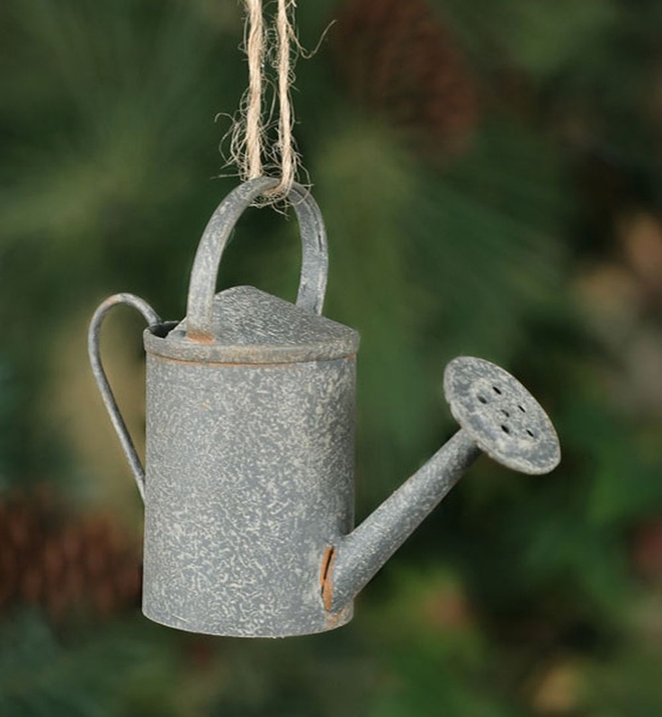 Creative DIY Garden Markers: I saw this idea on a community garden tour (Buy clearanced Christmas ornaments with a garden theme. Write the plant's name on the ornament and hang it from a mini shepherd's hooks made of wire. Very cute. Very clever.)