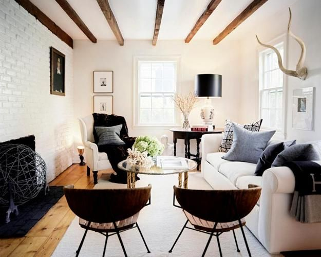 white brick wall and wooden ceiling beams in living room