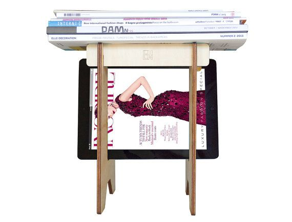 If you like it, buy it! Uiu is a laser cut wood magazine caddy born during this moment of transition from analogic to digital era in which we're living.  This modern magazine storage has a tablet ... #monitorstand #lasercut #organizer #monitorriser #lapdesk