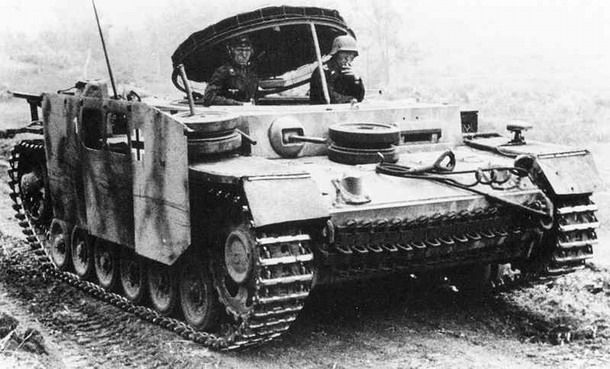 Rare photo of a munitions carrier built on the chassis of a Panzer III. Curiously, it has stubby schurzen.  Unknown location, most likely after 1943  ~ Vengeance_Lord