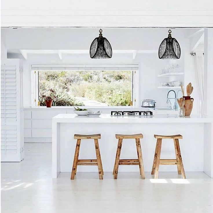 A perfect kitchen via @boholuxeinteriors . We have those stools if you love them #southafricanbeachhouse
