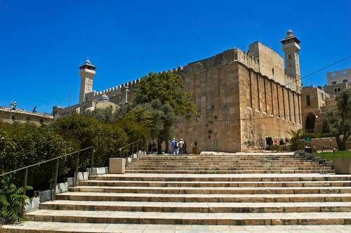 The Cave of the Patriarchs in Hebron, Palestine.  It is a shrine complex built in the 1st century BC with additions by the Crusaders (12th century AD). It centers around the Cave of Machpelah, an ancient double cave revered since at least 1000 BC as the burial site of the Hebrew patriarchs Abraham, Isaac and Jacob and their wives.