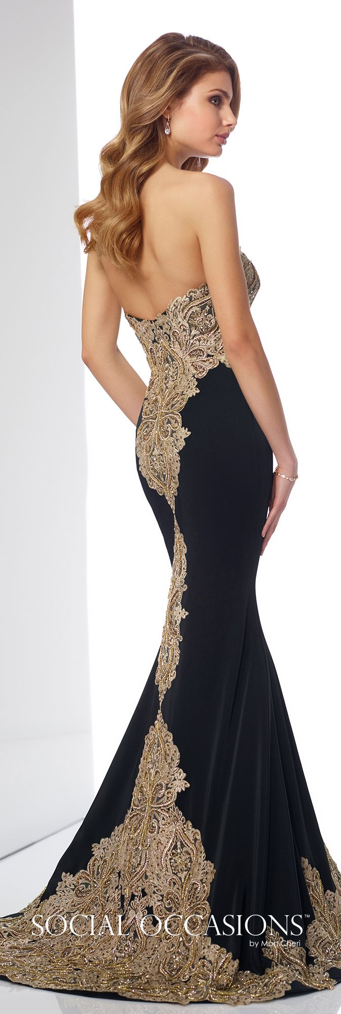 brand logo 217831  Strapless crepe and metallic lace fit and flare gown with sweetheart neckline, dropped waist bodice features hand-beaded lace that trails down back skirt, matching scalloped lace hemline, sweep train. Matching shawl and removable lace straps included.