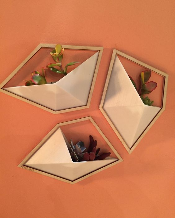 geometric wall planters were designed by AABSTRACT: