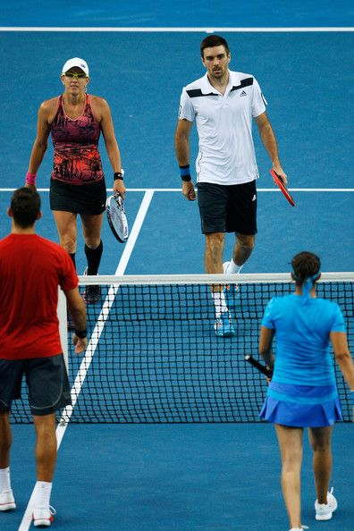 Anastasia Rodionova of Australia and Colin Fleming of Great Britain meet with Sania Mirza of India and Horia Tecau of Romania at the net in ...