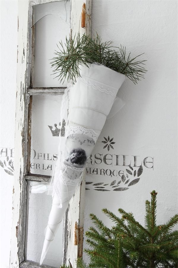 "Long white cone wrapped in organza and lace, filled with evergreen sprigs and hanging from a pretty ribbon...nice! (and ""fresh!"")"