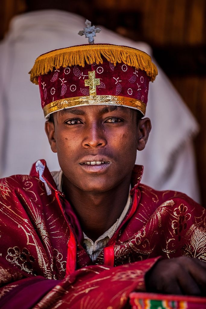 portrait young priest who celebrates the festival Hosanna (Palm Sunday) in Axum, tigray