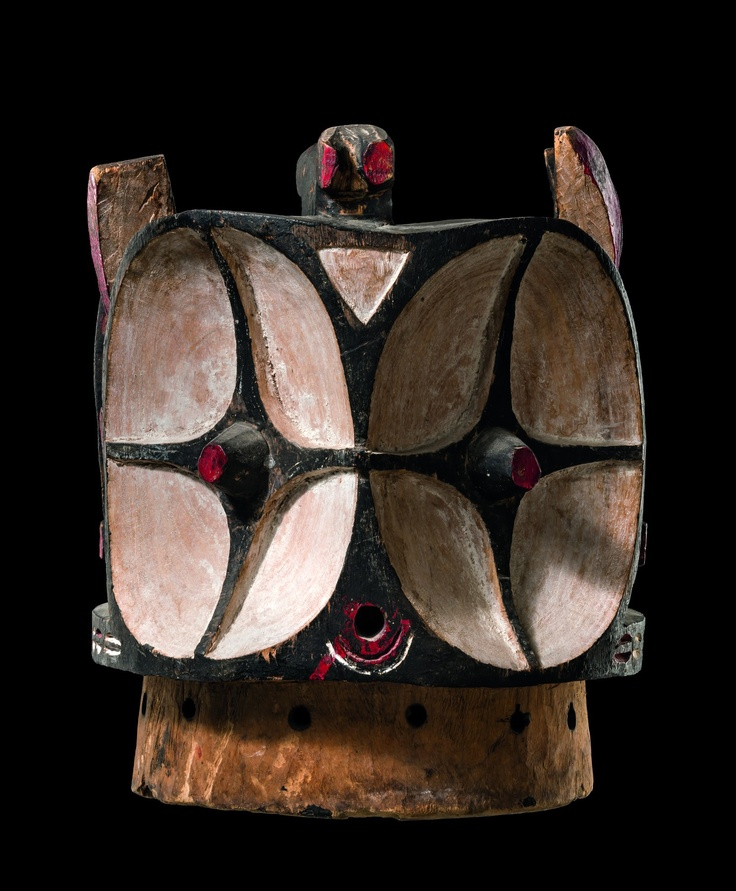 """Africa   Helmet mask """"kalunga"""" from the Bembe people of DR Congo   Wood, paint   the mask symbolizes """"kalunga"""", a Bembe society that functions as mother society and intervenes in tribal disputes; the society also decides tribal positions toward outside interventions. Today this mask is used in various celebrations. It supports a large, complex array of plumes and is worn with a costume that completely covers the dancer."""