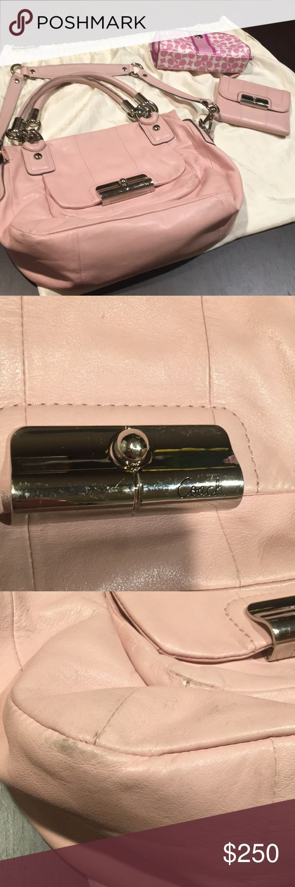 Pink Coach purse, wallet, and makeup bag Beautiful light pink Coach set. Item 1: Purse, can be used as top handle or shoulder. It has silver hardware. It has some wear ( please see pictures). The hardware has some scuff. Item 2: matching purse wallet in great used condition. Item 3: matching makeup bag. The outside looks great but the inside has some make up marks.  Comes with dust bag. Coach Bags Shoulder Bags