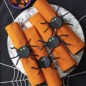 Instead of traditional napkin rings, make these spooky spider napkin rings for a Halloween party.