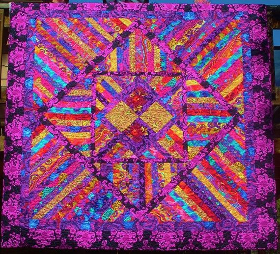 PURPLE PASSION - Kaffe Collective fabrics featured in this one of a kind quilt.