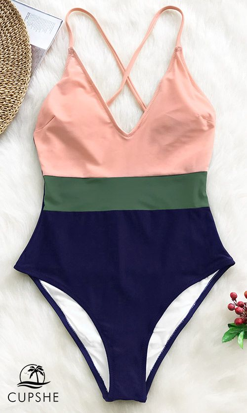1689b7dc02 The pink, green and navy Color Block One-Piece Swimsuit exudes a  sophisticated vibe