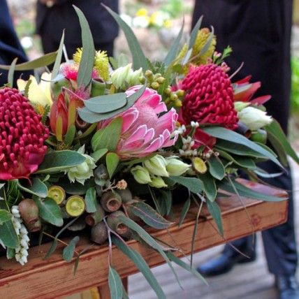 Red waratah, gum nuts, pink protea, serruria (blushing bride), pieris (Andromeda), candlestick and acorn banksia, eucalyptus foliage, leucadendron 'safari sunset' - what a lot of choice!