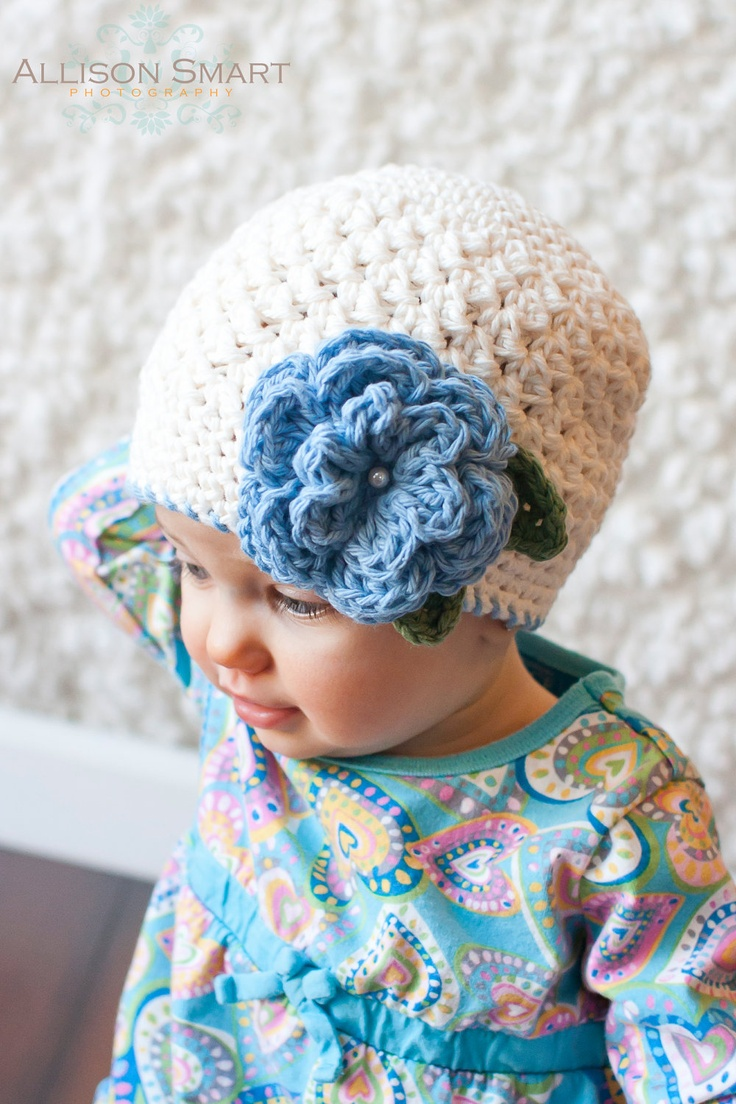{Girls Crochet Beanie with Flower | Etsy} Oh my, that little pearl in the center. SO CUTE.