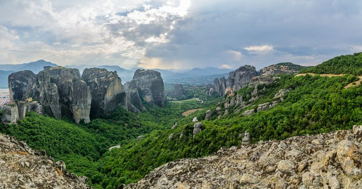 """The Metéora, literally meaning """"suspended in the air"""", is a formation of huge monolithic pillars and hill-like rounded boulders. It is also associated with one of the largest Eastern Orthodox monasteries in Greece, second in importance only to Mt. Athos."""