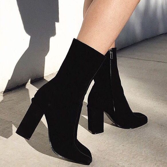 A black suede above ankle boot with a cut out block heel, square toe,  stitch panel detail and inner side zip for entry. Leather upper and  synthetic lining.