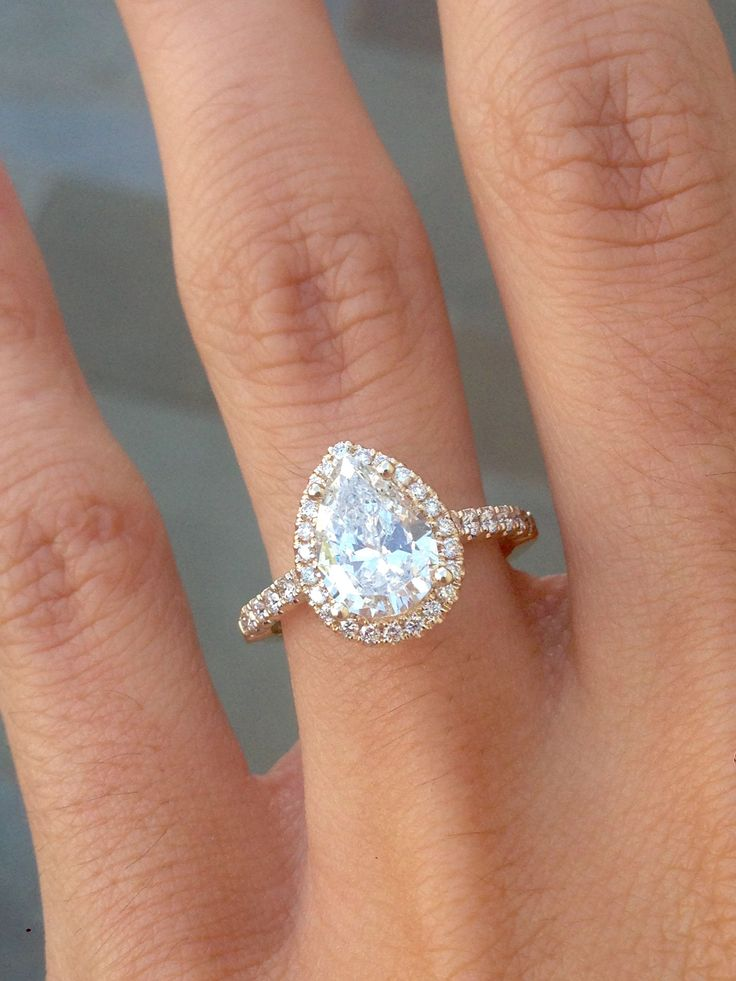 Yellow Gold Pear Diamond with Halo Engagement ring