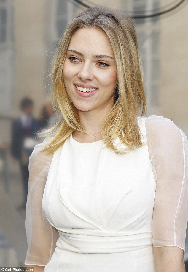 Flawless: Scarlett kept her appearance pure by wearing minimal make-up on her flawless complexion, and had her blonde locks loose around her shoulders
