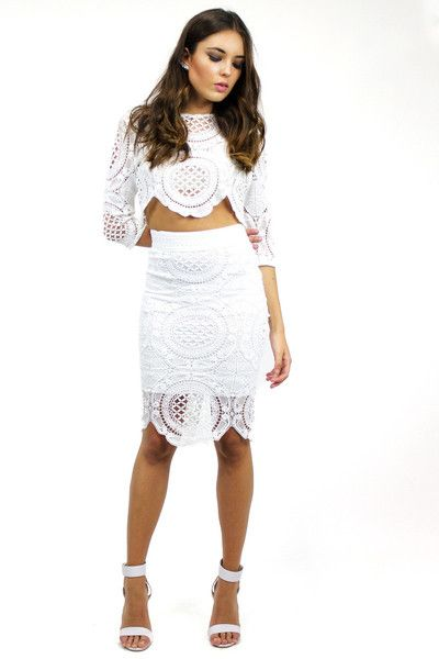 KENDALL LACE TOP & SKIRT SET WHITE STYLE DETAILS:  White crochet lace style top and skirt set Crew neckline  Stretch waist skirt Zipper up back of see-through top 3/4 length sleeves  FIT DETAILS:  Comfortable lace fabric Slight stretch in skirt Standard Australian sizing  STYLING:  This set is an elegant pair, ready-to-wear for nights out on the town Can be worn with a favourite pair of heels or even mix and match the set pieces with a t-shirt or denim shorts
