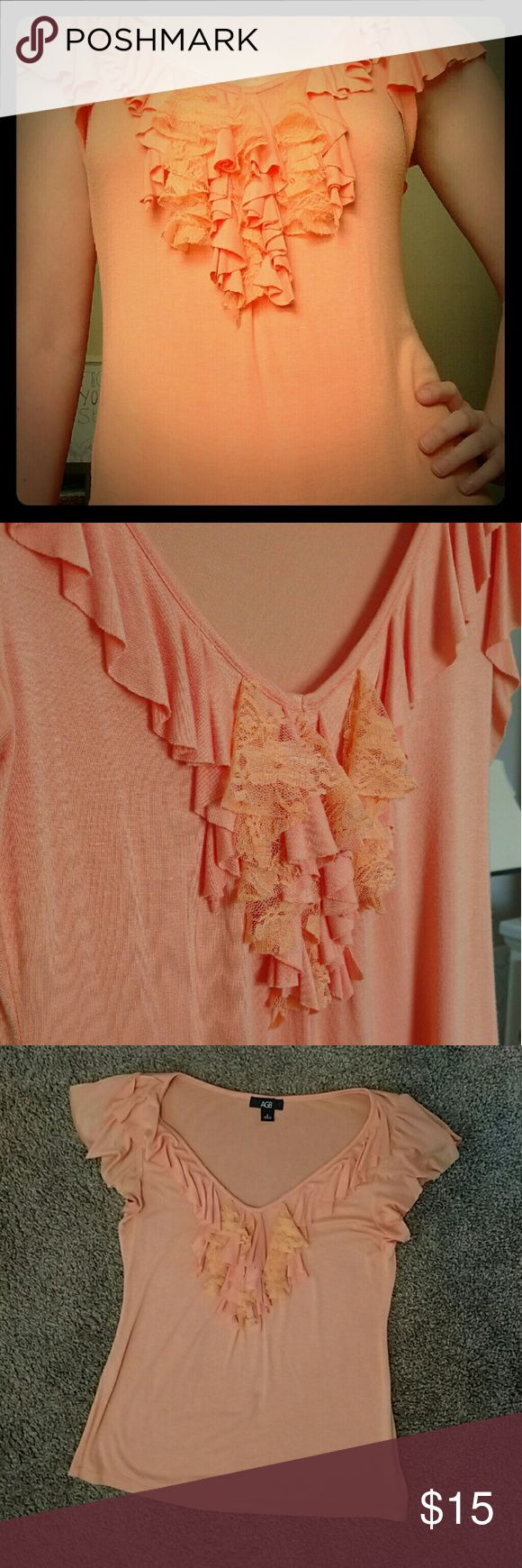 AGB Brand Ruffle Front Top This top is so feminine with its ruffles, loose sleeves, and soft peach color. Pair it with jeans and flats, or a blazer and nude heels for the office! 97% rayon and 3% spandex. Like new! AGB Tops Blouses