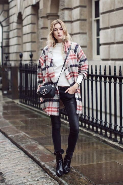 Camille Over the Rainbow has rainy day style to learn from: grab a statement coat and pair with simple basics (all in black so splash marks won't be an issue)