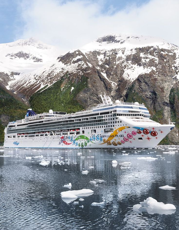 Norwegian cruises to Alaska from Seattle. The Norwegian Pearl cruise ship in the Tracy Arm Fjord Alaska.