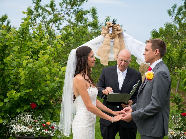 Stunning Orchard Wedding Ceremony in Niagara. Beautiful wedding details of a wedding at Orchard Croft Boutique. #JoshBellinghamPhotography