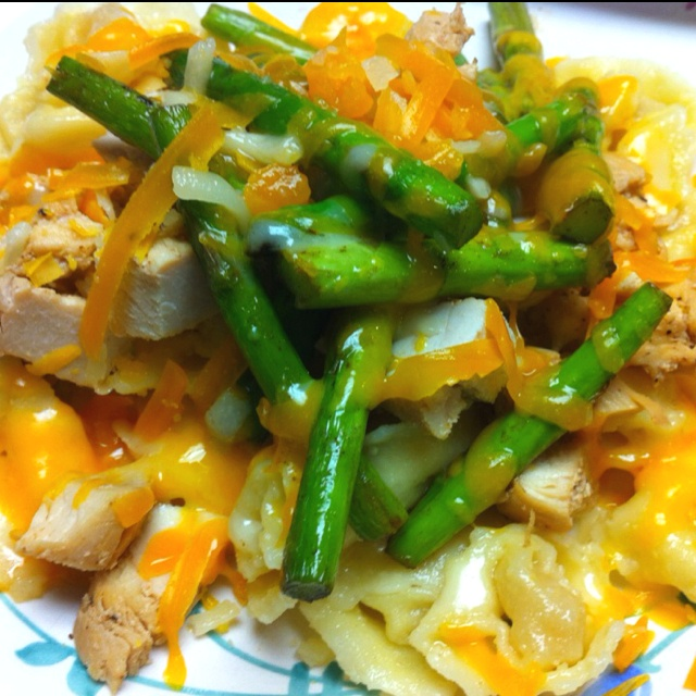 Tortalini topped with sautéd asparagus, grilled chicken and cheese.