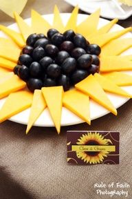 Great idea for little appetizers at the tables. :)  Find all fruit and cheeses that could look like a sunflower.