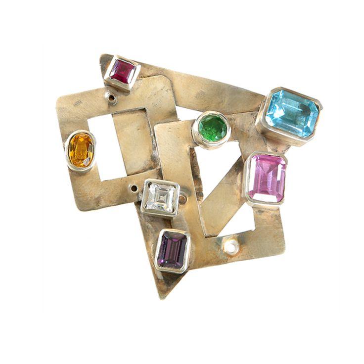 Giovanna L'Angioina: anello composto da varie figure geometriche in argento martellato e vari citrini incastonati