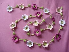 Ravelry: Prinzessinnengirlande/ Blumenkette pattern by Inken Jochimsen curtain tiebacks, maybe?