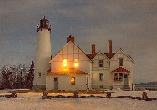Point Iroquois Light is a lighthouse on a Chippewa County bluff in the U.S. state of Michigan. Point Iroquois and its light mark the division line between Whitefish Bay and the western end of the St. Marys River, the connection between Lake Superior and other Great Lakes.  Point Iroquois includes a larger geographic area than the light station site. It was named for the Iroquois warriors massacred there by the Ojibwe in 1662.