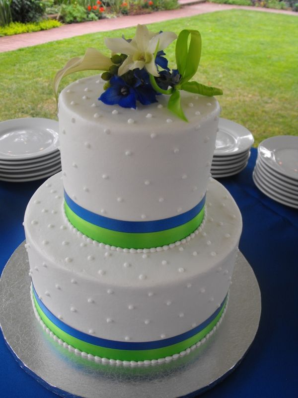 swiss dot wedding cake with royal blue and lime green stripes.  Love this - but would want navy, not blue