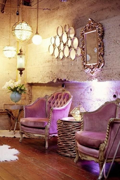 i love everything from the cement walls to the globe lights purple chairs rustic mirror and splash of blue flower vase