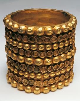 Gold bracelet decorated with studs / 700 B.C.Phoenician art, 7th Century B.C.  Gold bracelet decorated with studs.  Carambolo treasure found in Camas, Spain. Museo Arqueologico Nacional, Madrid