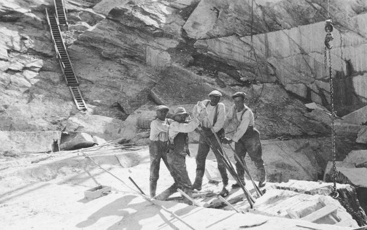 Workmen at a soapstone quarry.