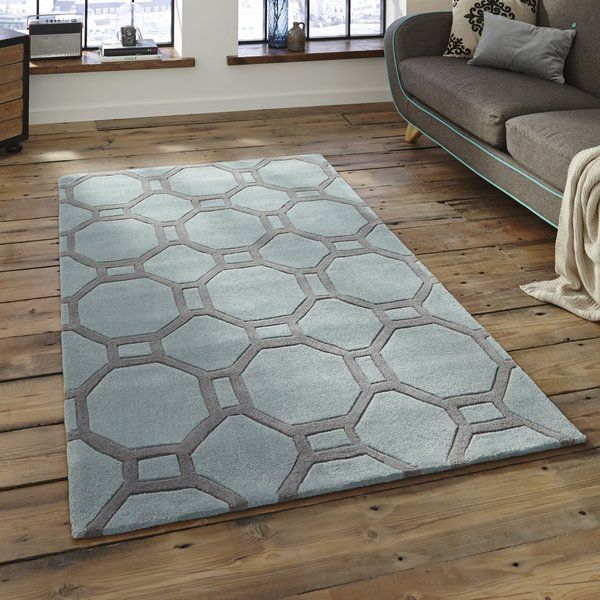 Tufted by hand, this rug features a geometric design in soft blue and grey hues. Perfect for bringing contemporary flair to any home, it looks great in your living room, bedroom or hallway.