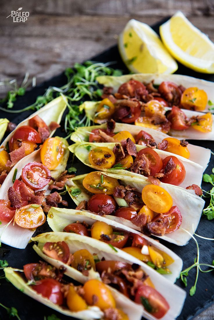 BLT Endive Bites. A fresh, low-carb appetizer or side dish inspired by the combination of bacon, lettuce, and tomatoes.