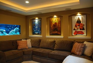 Nice up-lighting in the ceiling, accent lights for the movie posters and a sweet salt water tank. I'm not a big fan of movie style seating in basement…