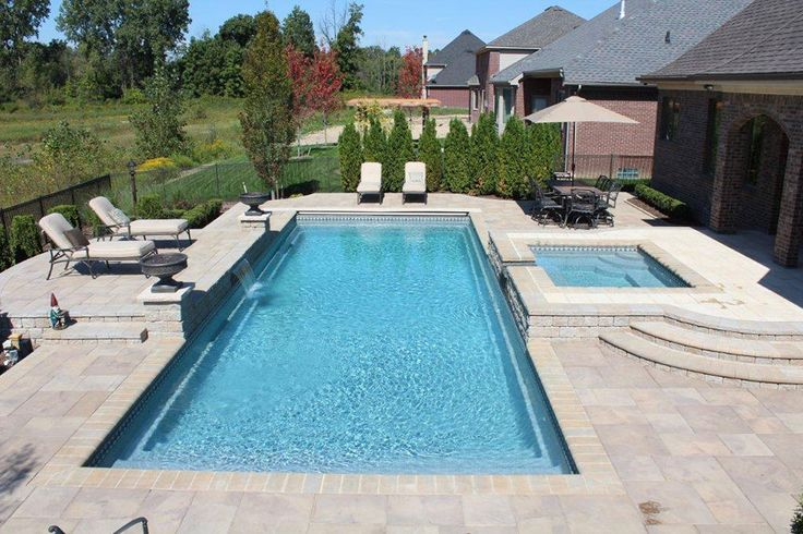 rectangular pool with spa and water feature