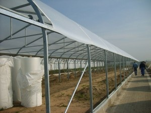 """SolaWrap™ a constructed Poly Keder , is a greenhouse covering that saves more energy.  Its unique German bubble design is specifically engineered to insulate and diffuse sunlight.   When a greenhouse is constructed utilizing the unique interlocking mounting system profile attachment, the """"keder"""" locking mechanism ensures a water and air-tight structure able to withstand the most extreme elements and climates."""